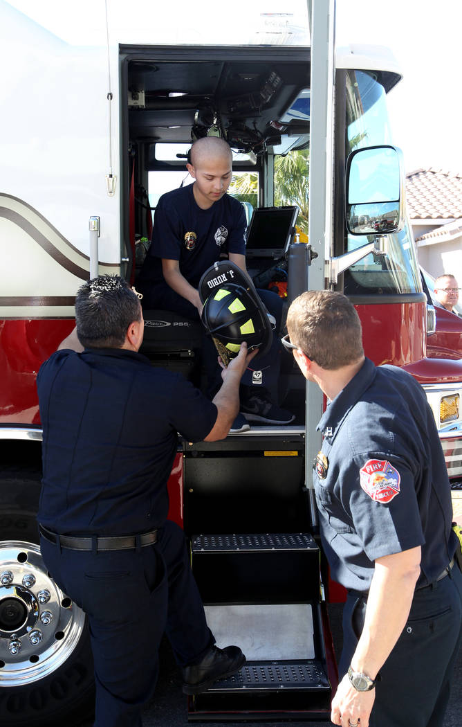 Leukemia patient Johnathan Rubio, 16, arrives home on a North Las Vegas Fire Department engine after being released from Summerlin Hospital Medical Center on Tuesday, Feb. 6, 2018. Rubio is a memb ...