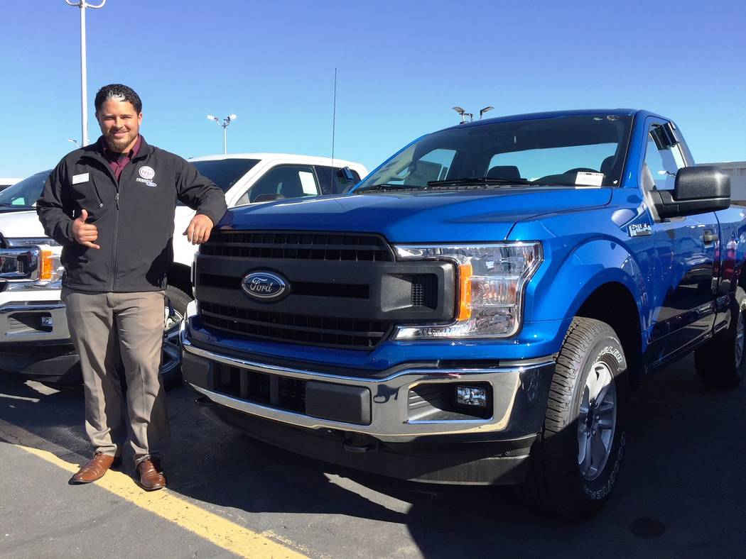 Friendly Ford Sales consultant Sheldon Pyke is seen with the 2018 Ford F-150 at Friendly Ford, 660 N. Decatur Blvd.
