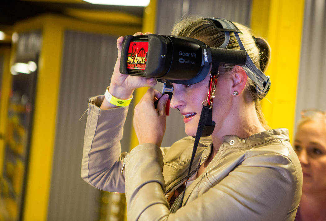 Amanda Lewis of West Palm Beach, Fla., puts on her virtual reality goggles to ride the Big Apple Coaster at New York-New York in Las Vegas on Wednesday, Feb. 7, 2018.  Patrick Connolly Las Vegas R ...
