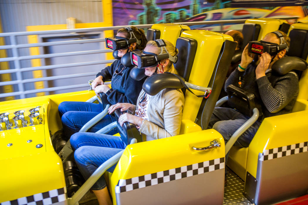 Ashley Day, left, and Amanda Lewis, second from left, of West Palm Beach, Fla., ride the Big Apple Coaster with virtual reality goggles at New York-New York in Las Vegas on Wednesday, Feb. 7, 2018 ...