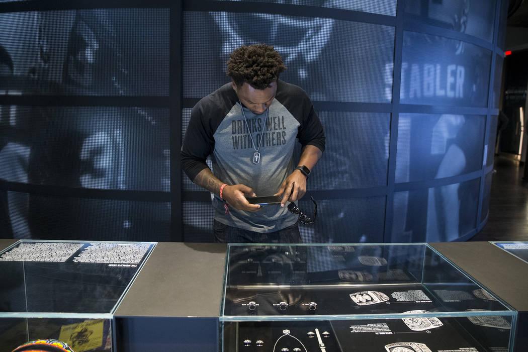 Eric Fields photographs a display in the Raiders Preview Center at Town Square Las Vegas in Las Vegas, Tuesday, Feb. 6, 2018. Erik Verduzco Las Vegas Review-Journal @Erik_Verduzco