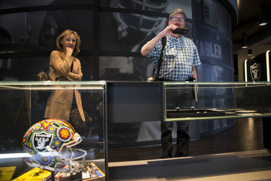 Petra Dilone, left, and her friend Eric Courtney, visit the Raiders Preview Center at Town Square Las Vegas in Las Vegas, Tuesday, Feb. 6, 2018. Erik Verduzco Las Vegas Review-Journal @Erik_Verduzco