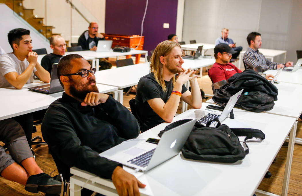 Thomas Shannon, front left, and Domingo Rosa, center, at a JavaScript crash course at PunchCode on Casino Center Boulevard on Thursday, Feb. 8, 2018.  Patrick Connolly Las Vegas Review-Journal @PC ...