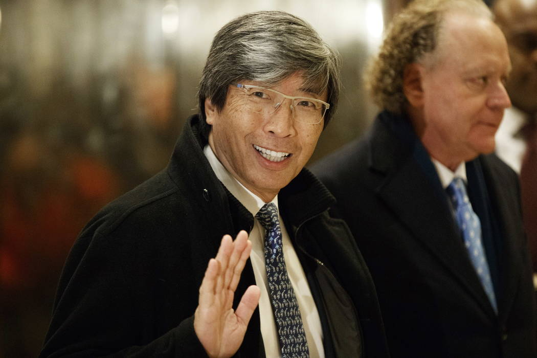 Pharmaceuticals billionaire Dr. Patrick Soon-Shiong waves as he arrives in the lobby of Trump Tower in New York for a meeting with President-elect Donald Trump in 2016.  (AP Photo/Evan Vucci, File)
