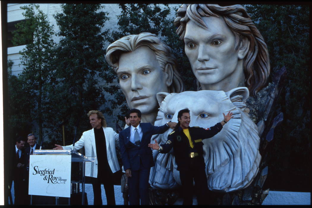The dedication of a new statue of magicians and entertainers Siegfried and Roy. This image is of Mirage Resorts Incorporated chairman Steve Wynn (blue suit) with Siegried Fischbacher (blonde) and  ...