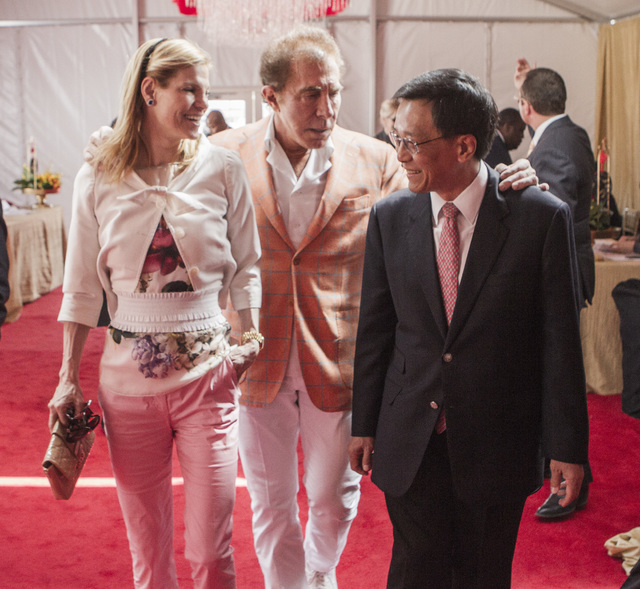 K.T. Lim, chairman, right,  and CEO of Genting Group, walks with Andrea and Steve Wynn, CEO of Wynn Resorts during the groundbreaking of  the $4 billion Resorts World Las Vegas resort property, th ...