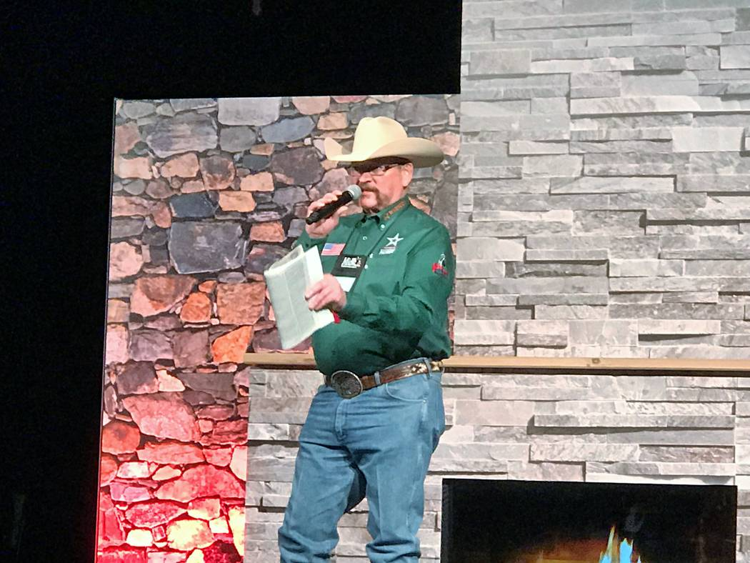 """Les Ohlhauser, an auctioneer who donates his time for events that raise money for conservation, starts the bidding at the """"day auction"""" during the Safari Club International annual Hunters' Convent ..."""