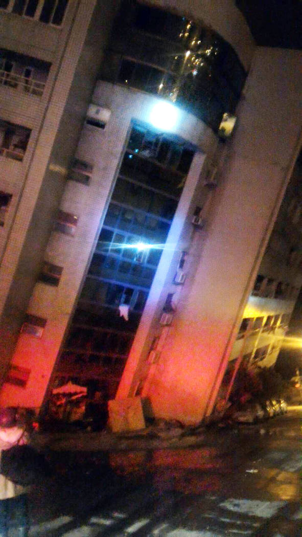 In this photo released by Hualien County Fire Bureau, an building collapsed by earthquake at an early morning in Hualien County, eastern Taiwan, Wednesday, Feb. 7 2018. A 6.4-magnitude earthquake  ...