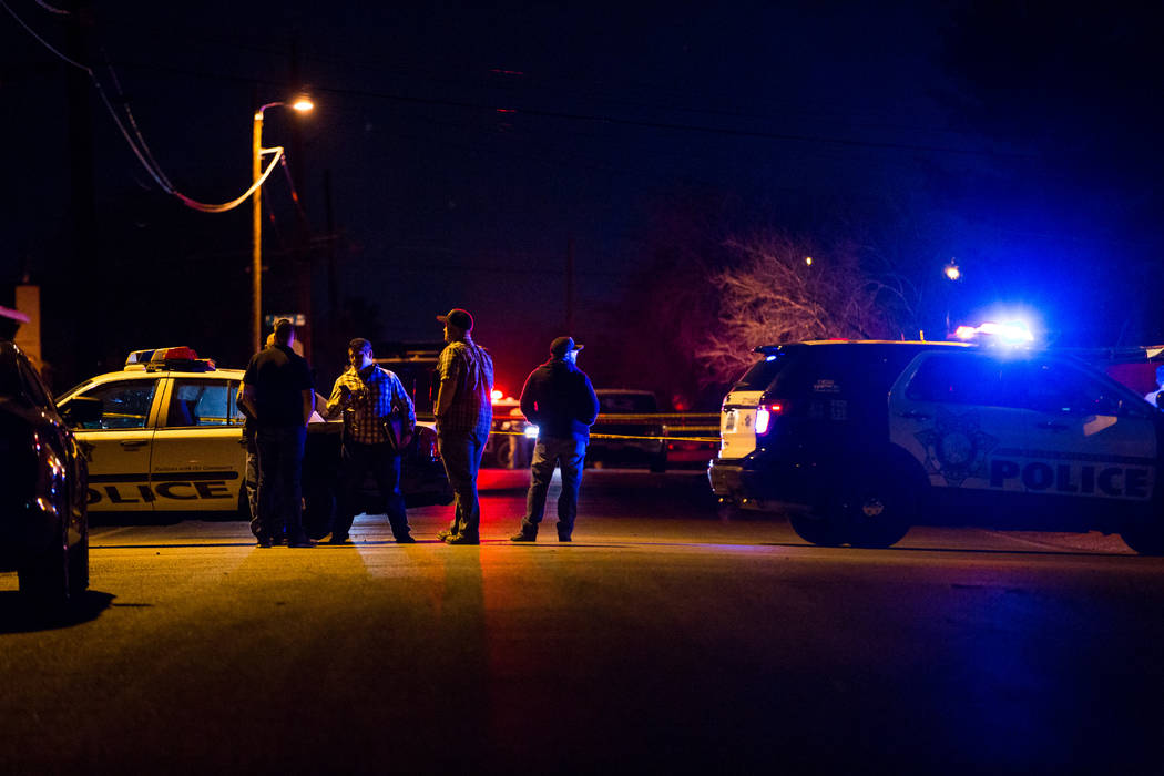 The Metropolitan Police Department investigates the scene of a homicide in which two people were killed and one person was hospitalized on May Avenue, near East Charleston Boulevard and Interstate ...