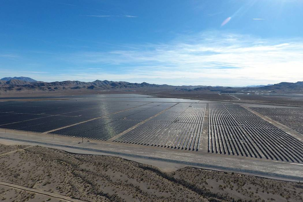Solar arrays line the desert floor of the Dry Lake Solar Energy Zone as part of the 179-megawatt Switch Station 1 and Switch Station 2 Solar Projects north of Las Vegas that were commissioned on M ...