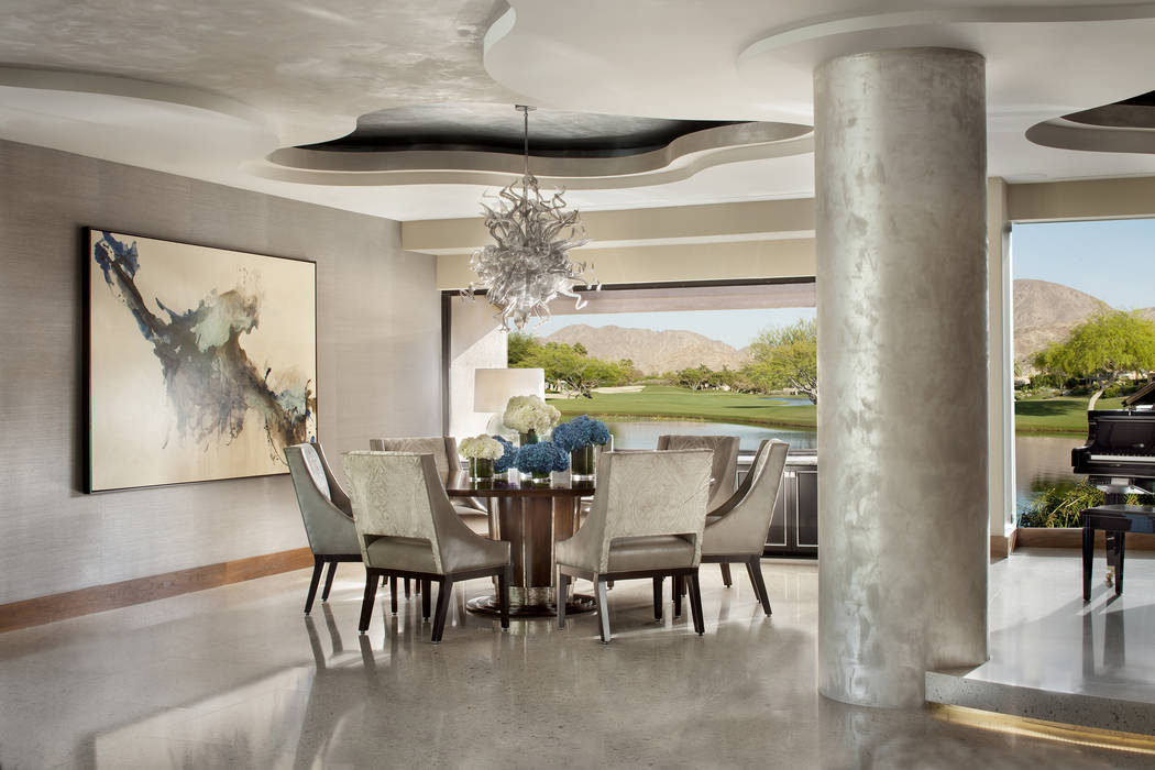 Willetts Design & Associates Ceilings and soffits in custom-painted silver, gold and champagne tones add luminous shine, complemented by the large-scale Cambria floor tiles, all of which work  ...