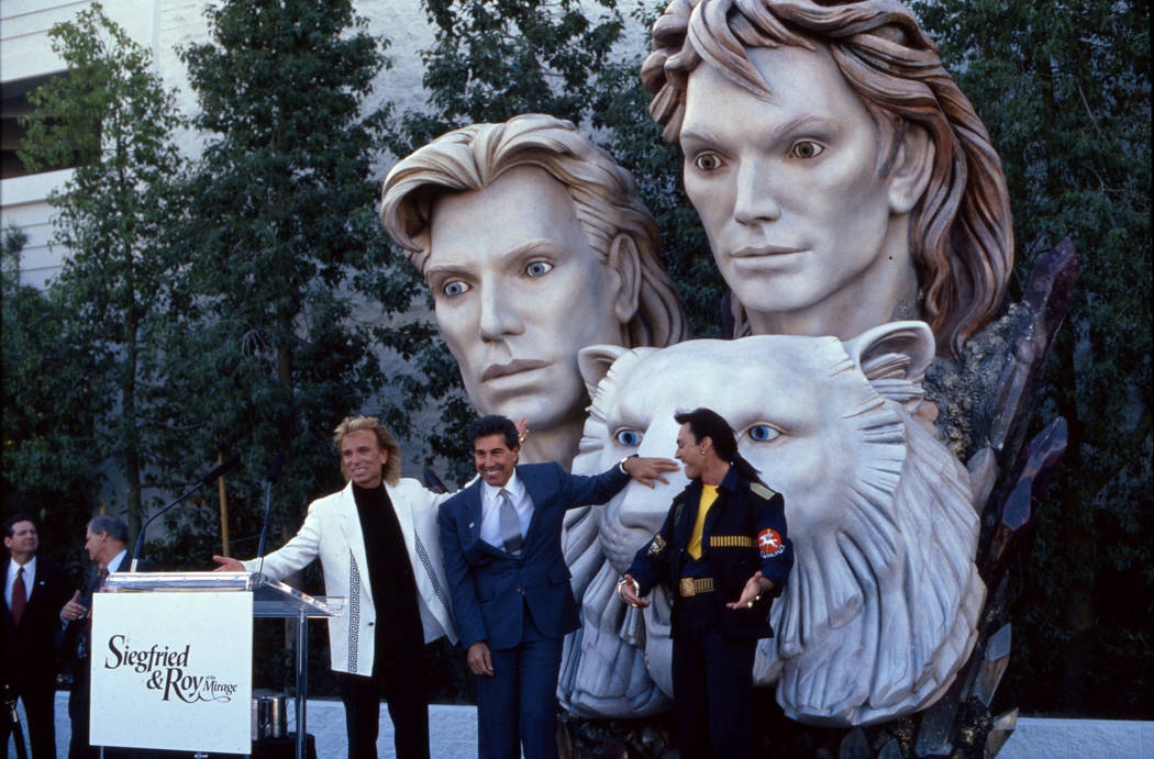 The dedication of a statue of magicians and entertainers Siegfried and Roy. This image is of Steve Wynn (blue suit) with Siegried Fischbacher (blonde) and Roy Uwe Ludwig Horn in front of the statu ...