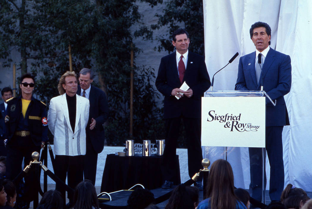 The dedication of a statue of magicians and entertainers Siegfried and Roy. This image is of Steve Wynn speaking with politician Ross Miller standing next to him and Siegfried Fischbacher (white j ...