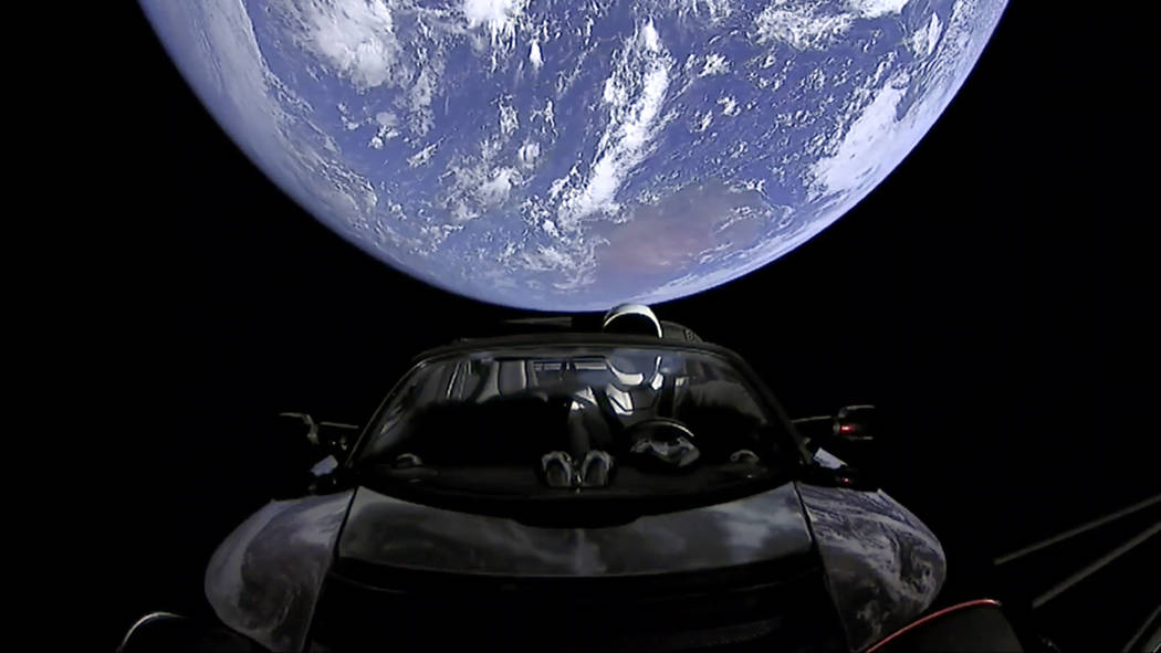 This image from video provided by SpaceX shows the company's spacesuit in Elon Musk's red Tesla sports car which was launched into space during the first test flight of the Falcon Heavy rocket on  ...