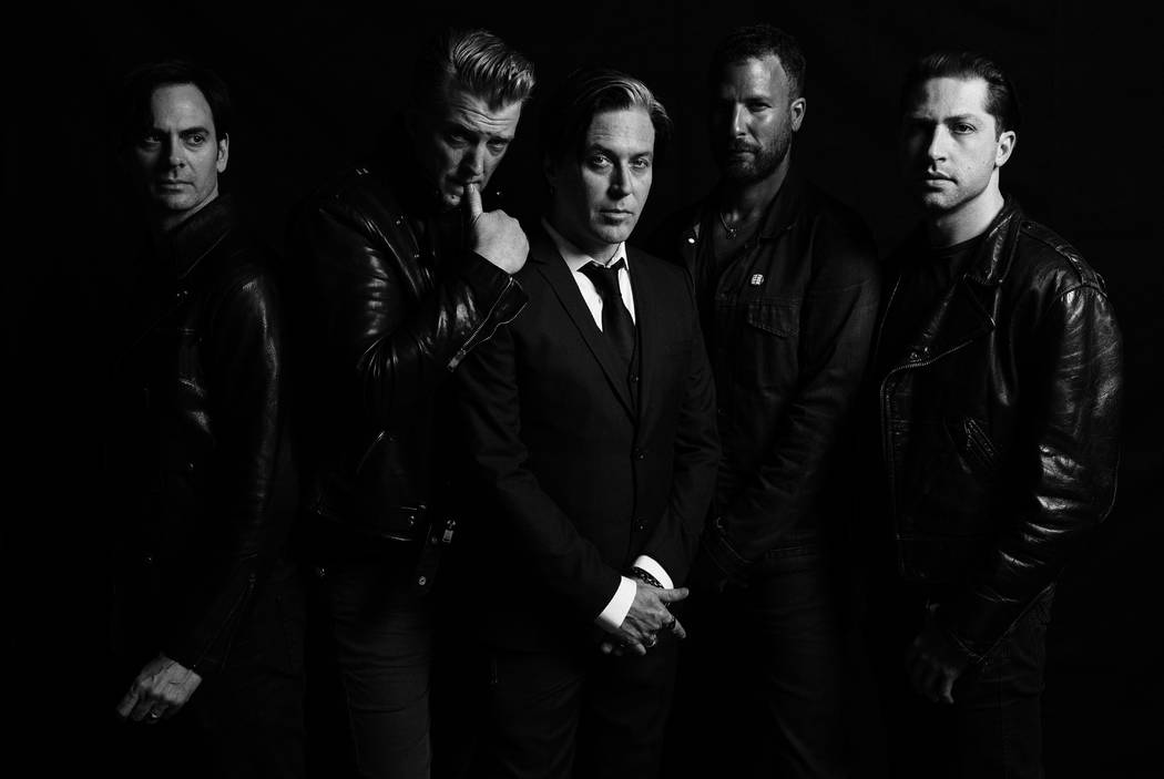 Queens of the Stone Age frontman Josh Homme, second from left, has been known to play the heel from time-to-time on stage. (Queens of the Stone Age)