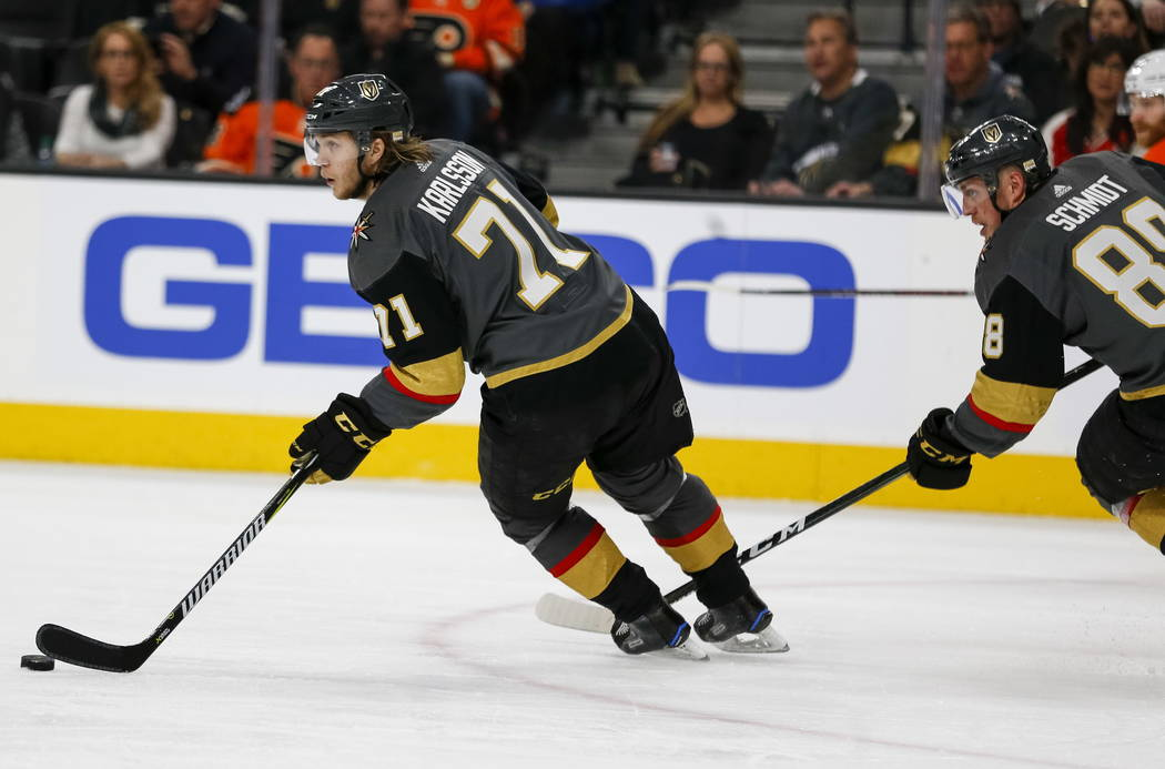 Vegas Golden Knights center William Karlsson (71) controls the puck as Knights defenseman Nate Schmidt (88) follows behind during the second period of an NHL hockey game between the Golden Knights ...