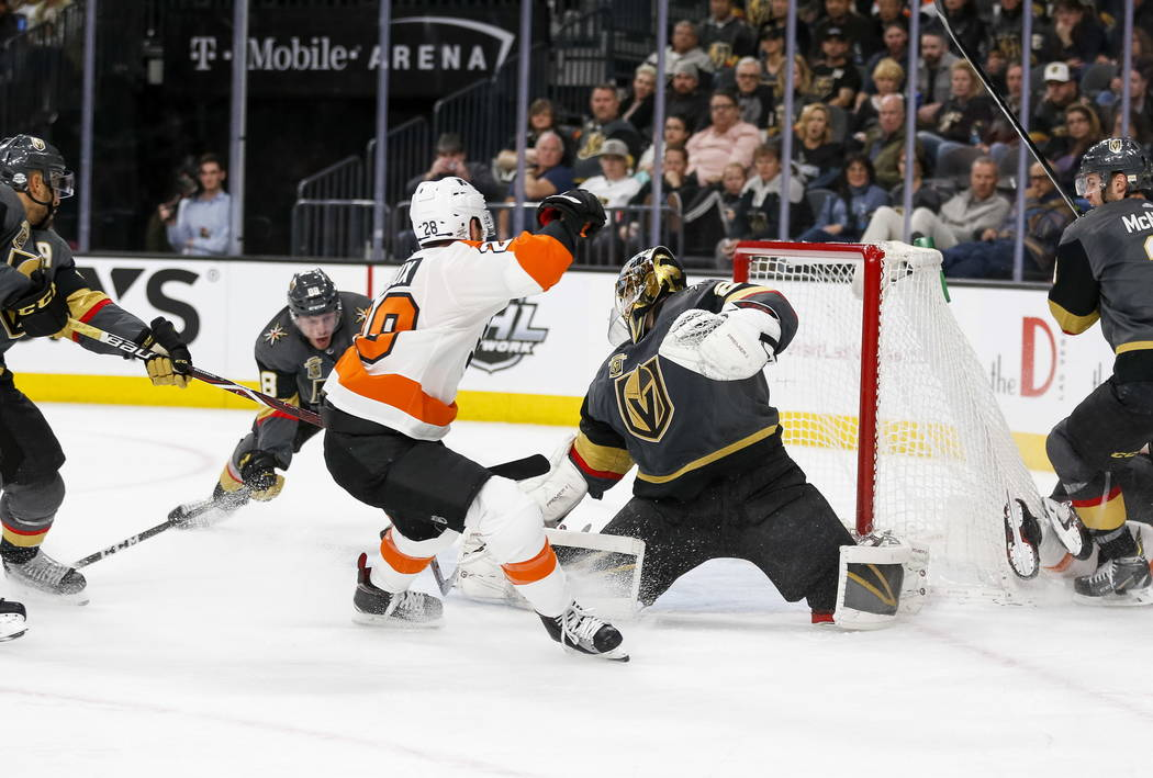 Philadelphia Flyers center Claude Giroux (28) shoots for a goal on Vegas Golden Knights goaltender Marc-Andre Fleury (29) during the second period of an NHL hockey game between the Golden Knights  ...