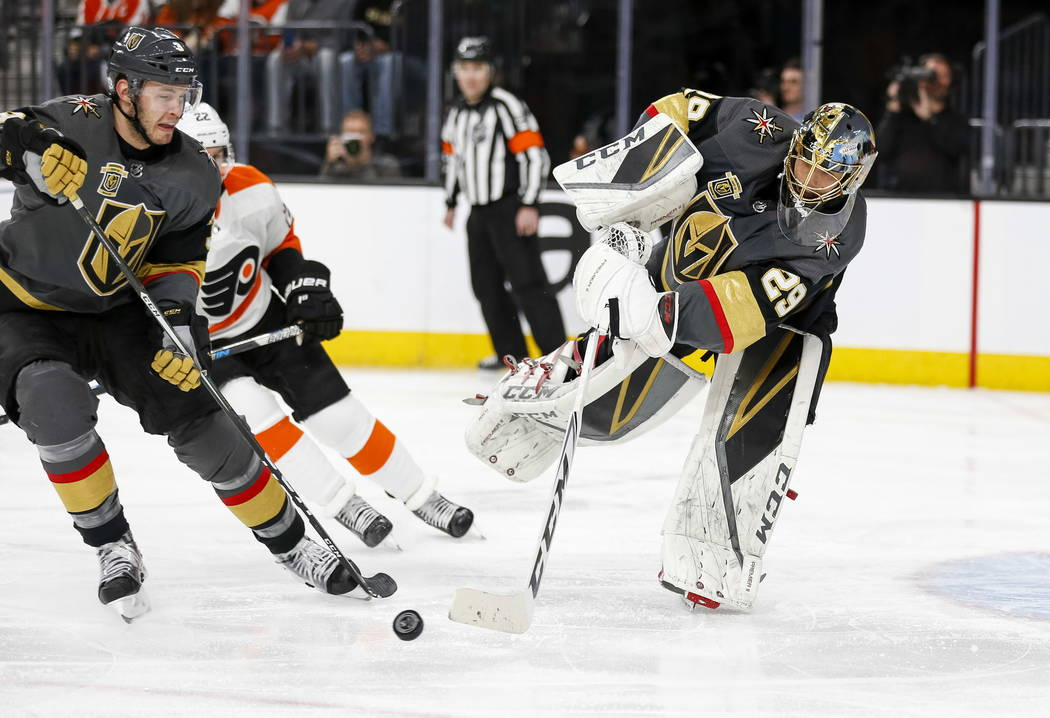 Vegas Golden Knights goaltender Marc-Andre Fleury (29) passes the puck past Knights defenseman Brayden McNabb (3) during the second period of an NHL hockey game between the Golden Knights and the  ...