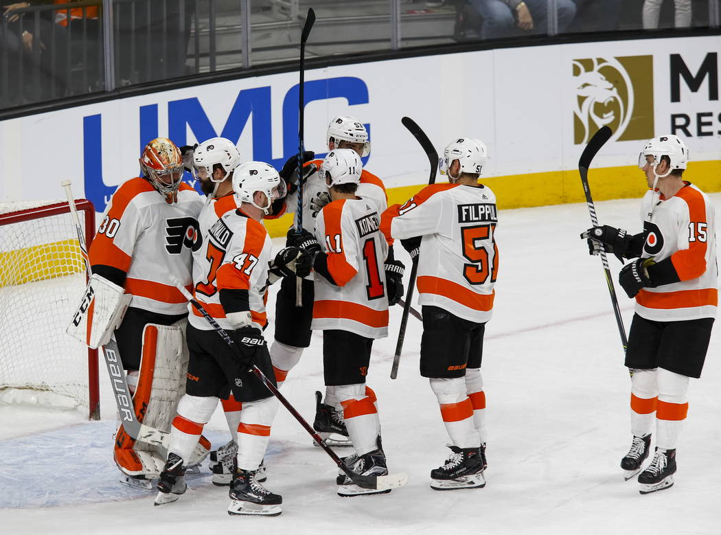 Philadelphia Flyers celebrate their 4-1 victory over the Vegas Golden Knights following an NHL hockey game at T-Mobile Arena in Las Vegas, Sunday, Feb. 11, 2018. Richard Brian Las Vegas Review-Jou ...