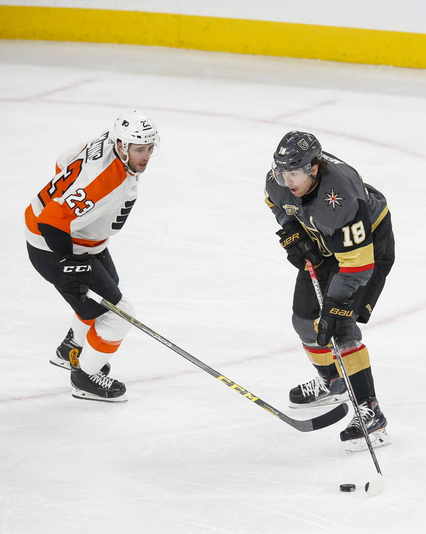 Vegas Golden Knights left wing James Neal (18) controls the puck as Philadelphia Flyers defenseman Brandon Manning (23) defends during the third period of an NHL hockey game between the Vegas Gold ...