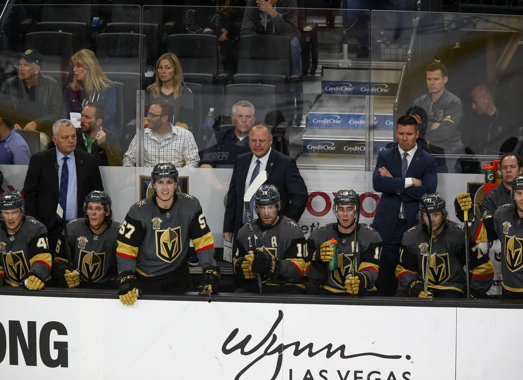 Vegas Golden Knights coach Gerard Gallant, center, and his team watch from the players bench his during the third period of an NHL hockey game between the Golden Knights and the Philadelphia Flyer ...