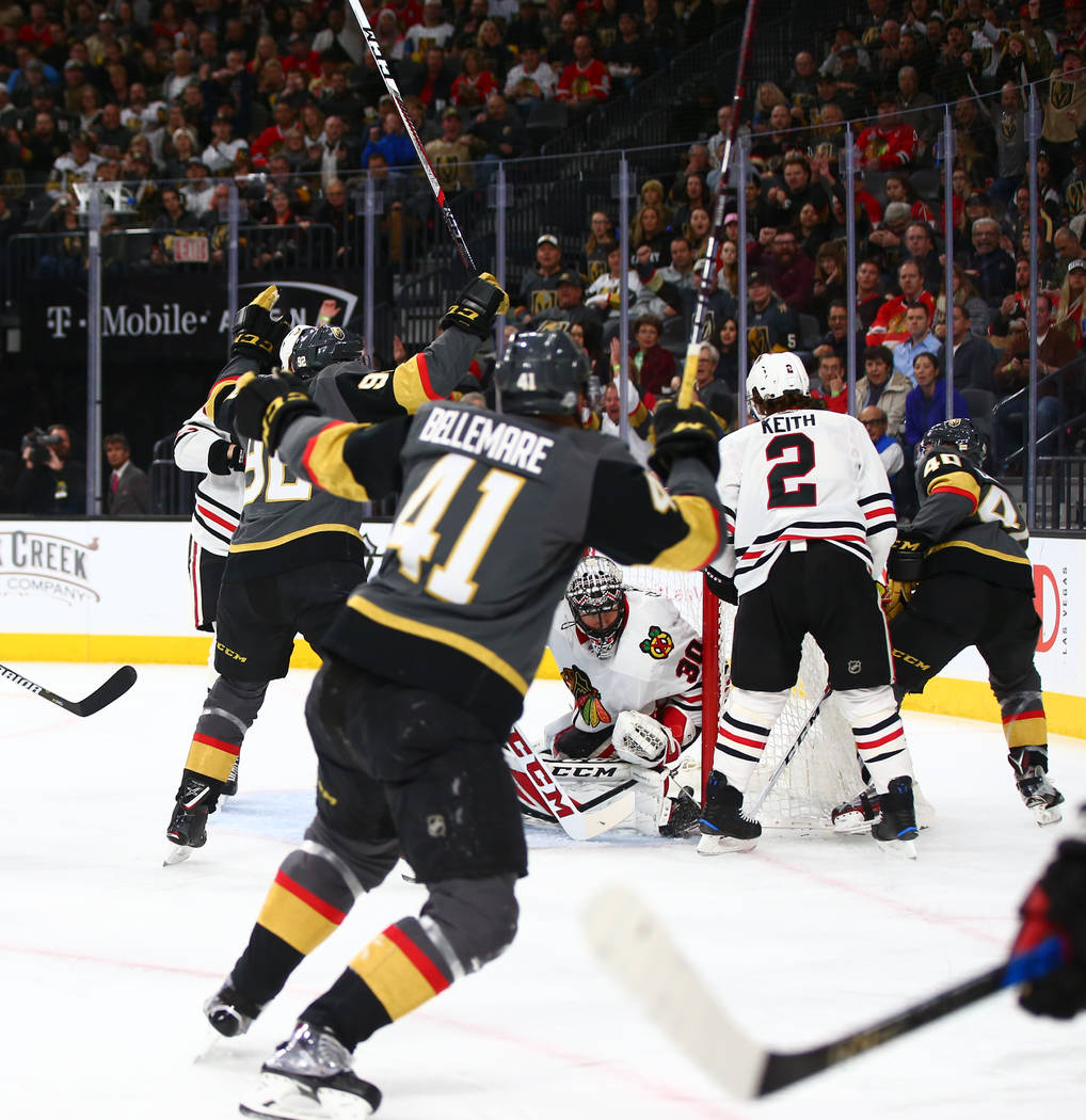 Golden Knights center Ryan Carpenter (40), with an assist from left wing Pierre-Edouard Bellemare (41), scores against the Chicago Blackhawks during an NHL game at T-Mobile Arena in Las Vegas on T ...
