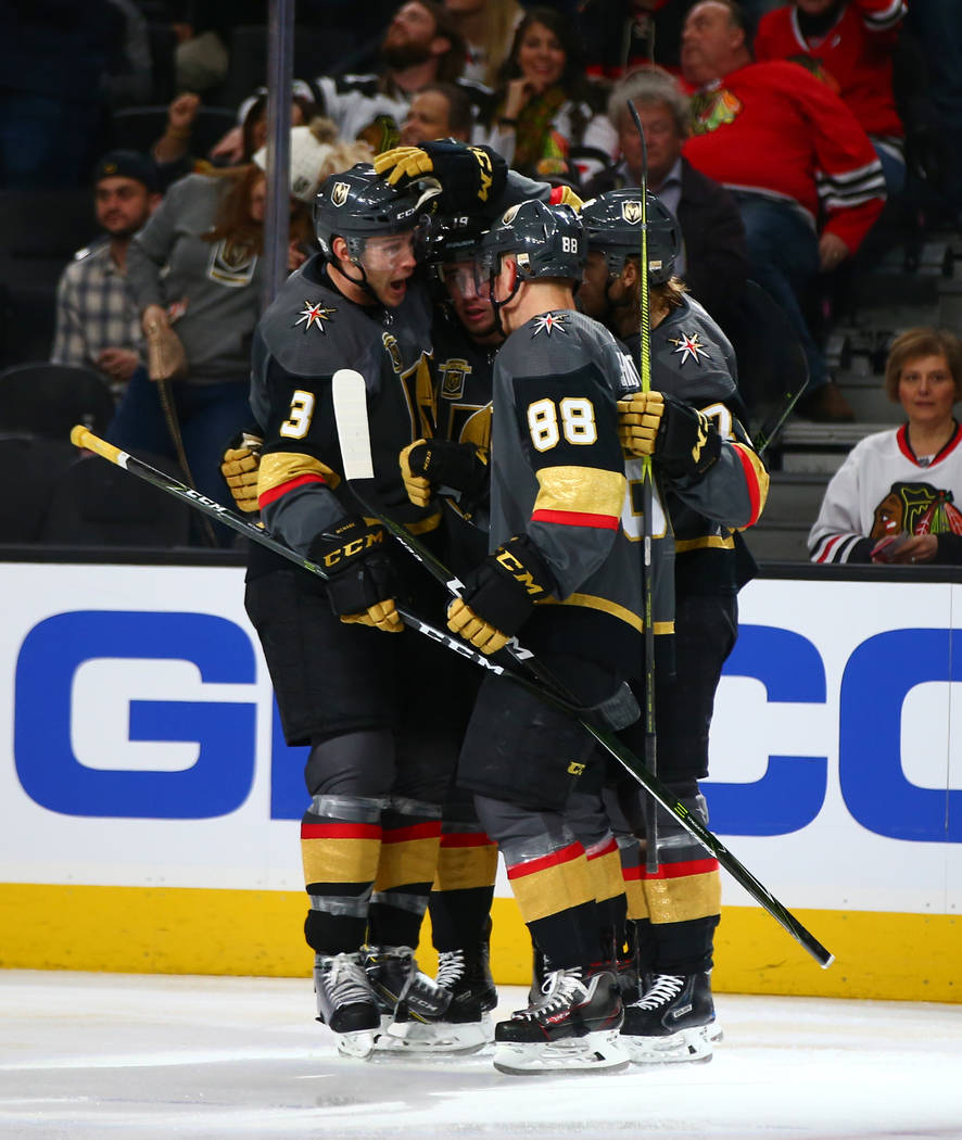 Golden Knights players celebrate a shot by right wing Reilly Smith (19) while playing the Chicago Blackhawks in an NHL game at T-Mobile Arena in Las Vegas on Tuesday, Feb. 13, 2018. Chase Stevens  ...