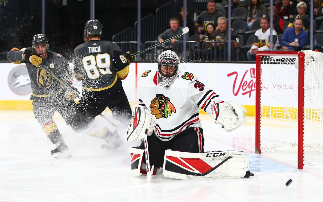 Chicago Blackhawks goaltender Jeff Glass (30) watches the puck pass by during an NHL game against the Golden Knights at T-Mobile Arena in Las Vegas on Tuesday, Feb. 13, 2018. Chase Stevens Las Veg ...