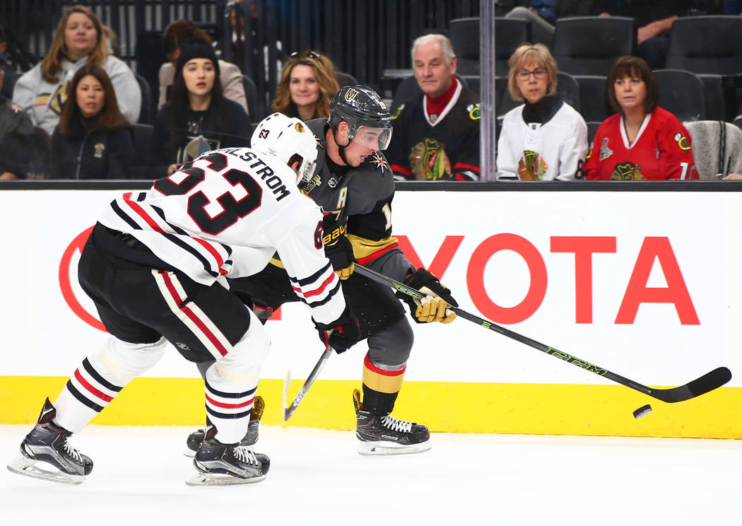 Golden Knights right wing Reilly Smith (19) moves the puck against Chicago Blackhawks defenseman Carl Dahlstrom (63) during an NHL game at T-Mobile Arena in Las Vegas on Tuesday, Feb. 13, 2018. Ch ...