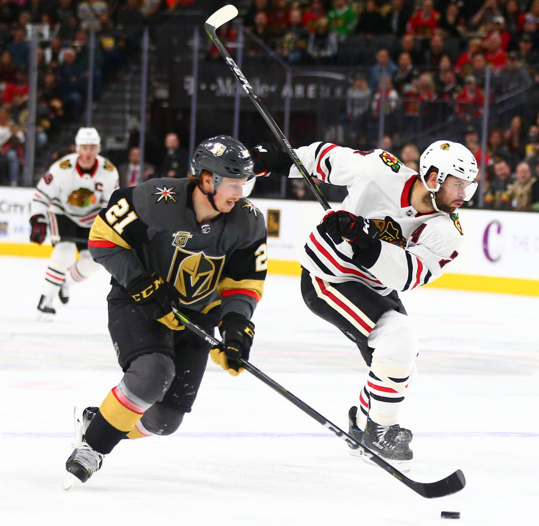 Golden Knights center Cody Eakin (21) moves the puck past Chicago Blackhawks defenseman Brent Seabrook (7) during an NHL game at T-Mobile Arena in Las Vegas on Tuesday, Feb. 13, 2018. Chase Steven ...