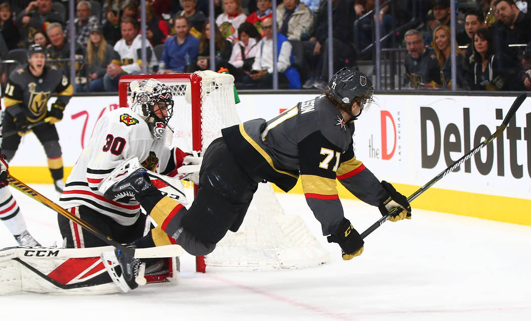 Golden Knights center William Karlsson (71) gets tripped up over Chicago Blackhawks goaltender Jeff Glass (30) during an NHL game at T-Mobile Arena in Las Vegas on Tuesday, Feb. 13, 2018. Chase St ...
