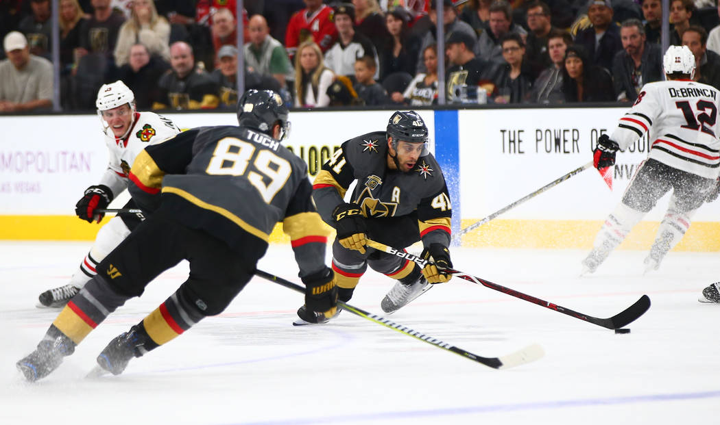 Golden Knights left wing Pierre-Edouard Bellemare (41) controls the puck alongside right wing Alex Tuch (89) during an NHL game at T-Mobile Arena in Las Vegas on Tuesday, Feb. 13, 2018. Chase Stev ...