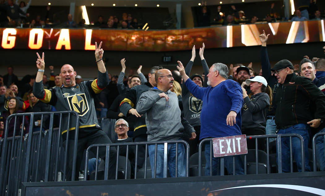 Golden Knights fans celebrate as the team makes an empty net goal against the Chicago Blackhawks during an NHL game at T-Mobile Arena in Las Vegas on Tuesday, Feb. 13, 2018. Chase Stevens Las Vega ...