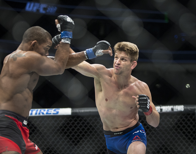 Mike Pyle lands a strike against Alex Garcia during UFC 207 at T-Mobile Arena on Friday, Dec. 30, 2016, in Las Vegas. Pyle, originally from Memphis, lives and trains in Las Vegas. Benjamin Hager/L ...