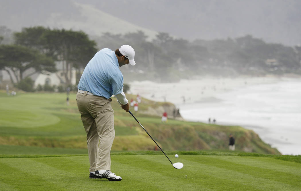 Dallas Cowboys quarterback Tony Romo hits from the 10th tee of the Pebble Beach Golf Links during the AT&T Pebble Beach National Pro-Am golf tournament in Pebble Beach, Calif. Romo has accepte ...