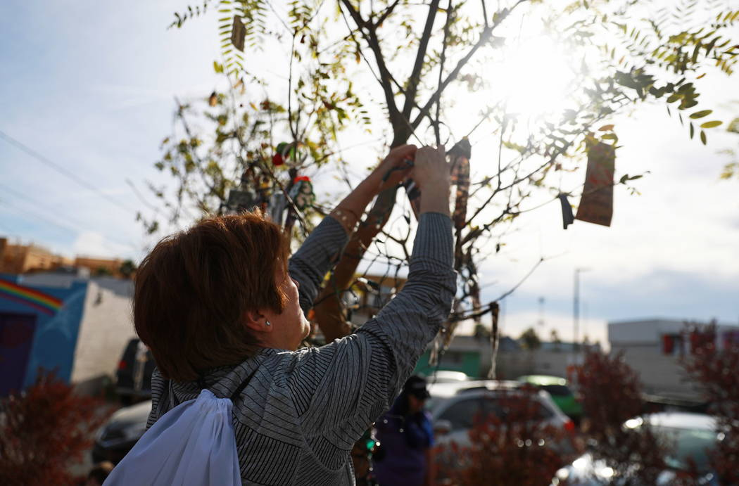 Angela Crolli fixes a decoration on a tree at the Healing Garden in Las Vegas on Saturday, Feb. 10, 2018.  Andrea Cornejo Las Vegas Review-Journal @DreaCornejo