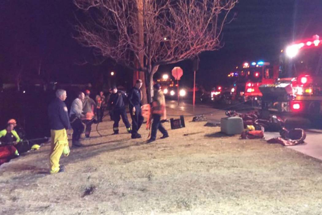 A Las Vegas Fire and Rescue crew begins to clear the scene at Soaring Gulls Drive and Harbor Island after pulling a vehicle from a lake in Desert Shores. Las Vegas police confirmed that one person ...