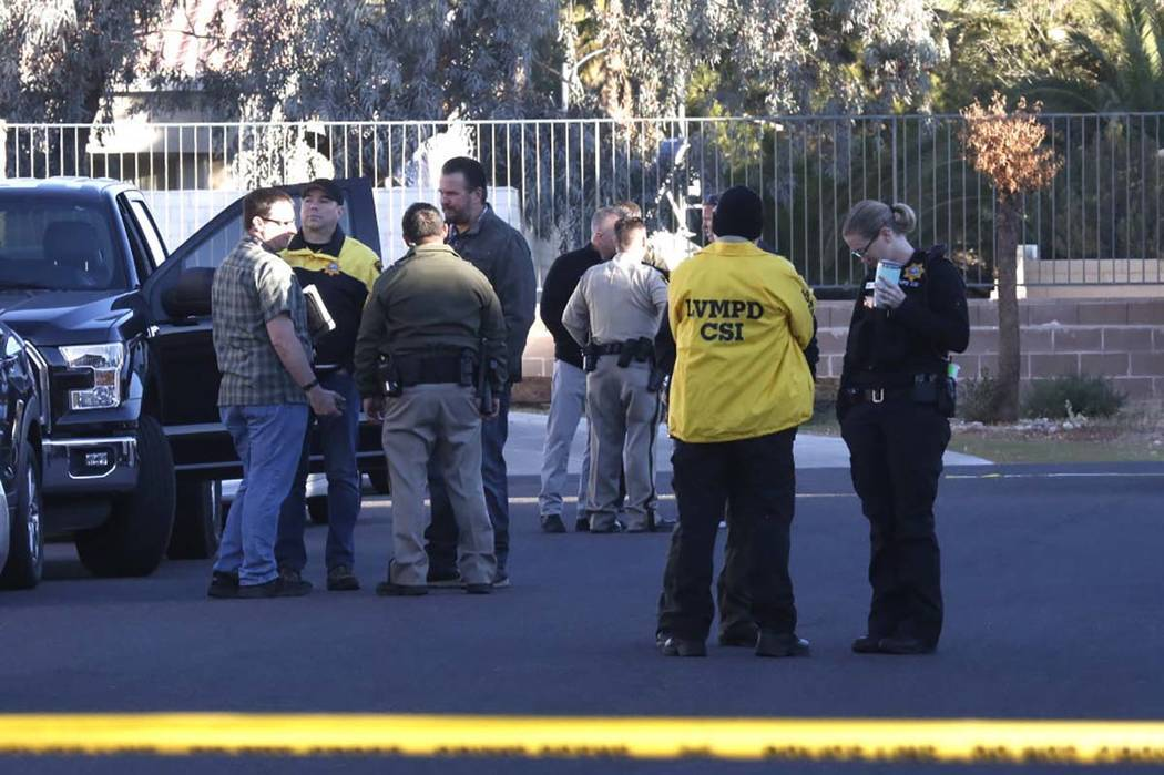 Las Vegas police investigate a homicide and kidnapping in the 3300 block of Robin Nest Court, near Desert Inn Road and Hualapai Way, Wednesday, Feb. 7, 2018, in Las Vegas. (Bizuayehu Tesfaye/Las V ...