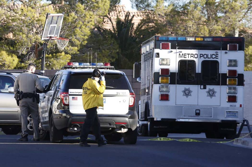 Las Vegas police investigate a shooting and kidnapping in the 3300 block of Robin Nest Court, near Desert Inn Road and Hualapai Way, Wednesday, Feb. 7, 2018, in Las Vegas. Bizuayehu Tesfaye/Las Ve ...
