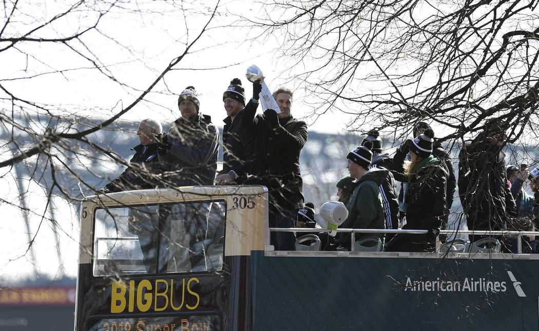 Philadelphia Eagles NFL football head coach Doug Pederson holds up the Vince Lombardi trophy during the Super Bowl LII victory parade, Thursday, Feb 8, 2018, in Philadelphia. From left are Eagles  ...