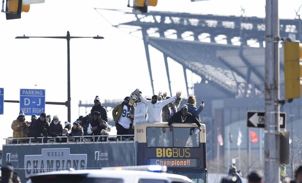 Philadelphia Eagles NFL football team players gesture to fansduring the Super Bowl LII victory parade, Thursday, Feb 8, 2018, in Philadelphia. (AP Photo/Michael Perez)
