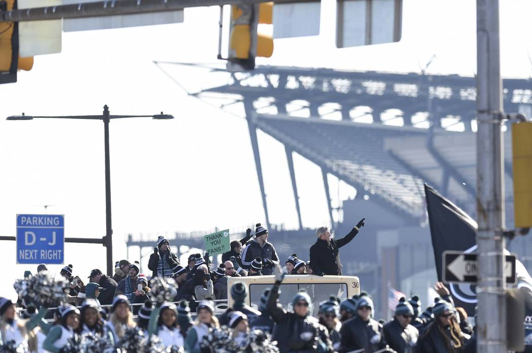 Philadelphia Eagles NFL football team head coach Doug Pederson points to the crowd gathered during the Super Bowl LII victory parade, Thursday, Feb 8, 2018, in Philadelphia. (AP Photo/Michael Perez)