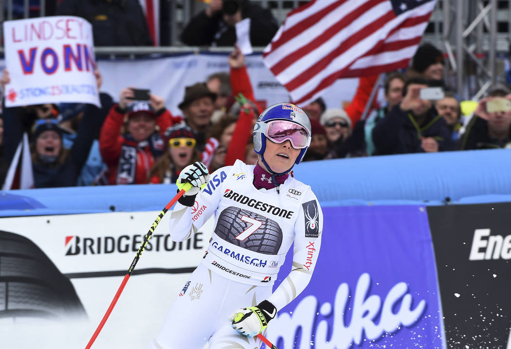 United States' Lindsey Vonn celebrates at the finish area during an alpine ski, women's world Cup downhill race, in Garmisch Partenkirchen, Germany, Sunday, Feb. 4, 2018. (AP Photo/Marco Tacca)