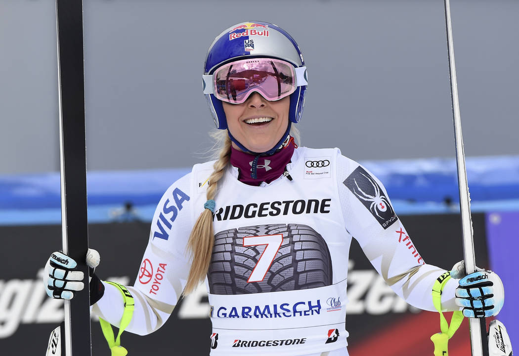 United States' Lindsey Vonn smiles at the finish area during an alpine ski, women's world Cup downhill race, in Garmisch Partenkirchen, Germany, Sunday, Feb. 4, 2018. (AP Photo/Marco Tacca)