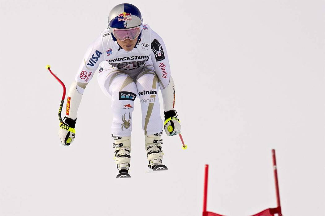 Lindsey Vonn of the United States speeds down the course during the women's super-G race at the Alpine skiing World Cup, in St. Moritz, Switzerland, Saturday, Dec. 9, 2017. (Jean-Christophe Bott/K ...