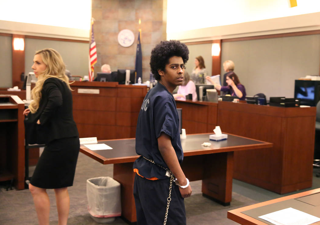 Richard Newsome, who fatally shot former Chaparral High School football player Richard Nelson, leaves the courtroom at the Regional Justice Center on Thursday, Feb. 8, 2018, in Las Vegas. Newsome  ...