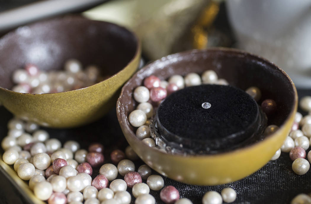 Beauty & Essex's $1000 dessert with a chocolate sphere encasing a 0.10-carat round, brilliant-cut white diamond, a heart-shaped locket filled with sugar jewels, two cups of espresso macchiato, ...