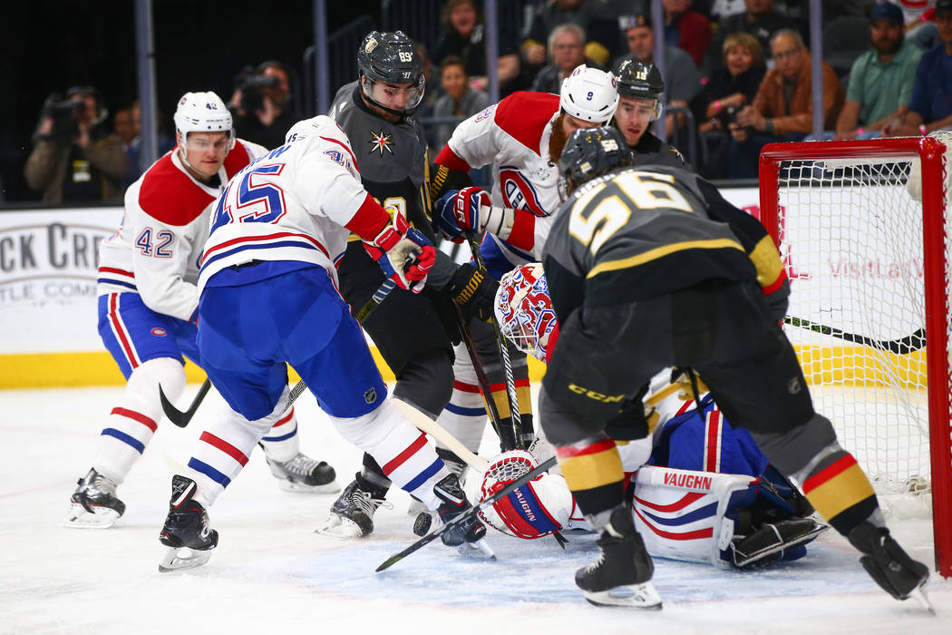 Golden Knights right wing Alex Tuch (89) and Golden Knights left wing Erik Haula (56) try to score against the Montreal Canadiens during an NHL hockey game at T-Mobile Arena in Las Vegas on Saturd ...