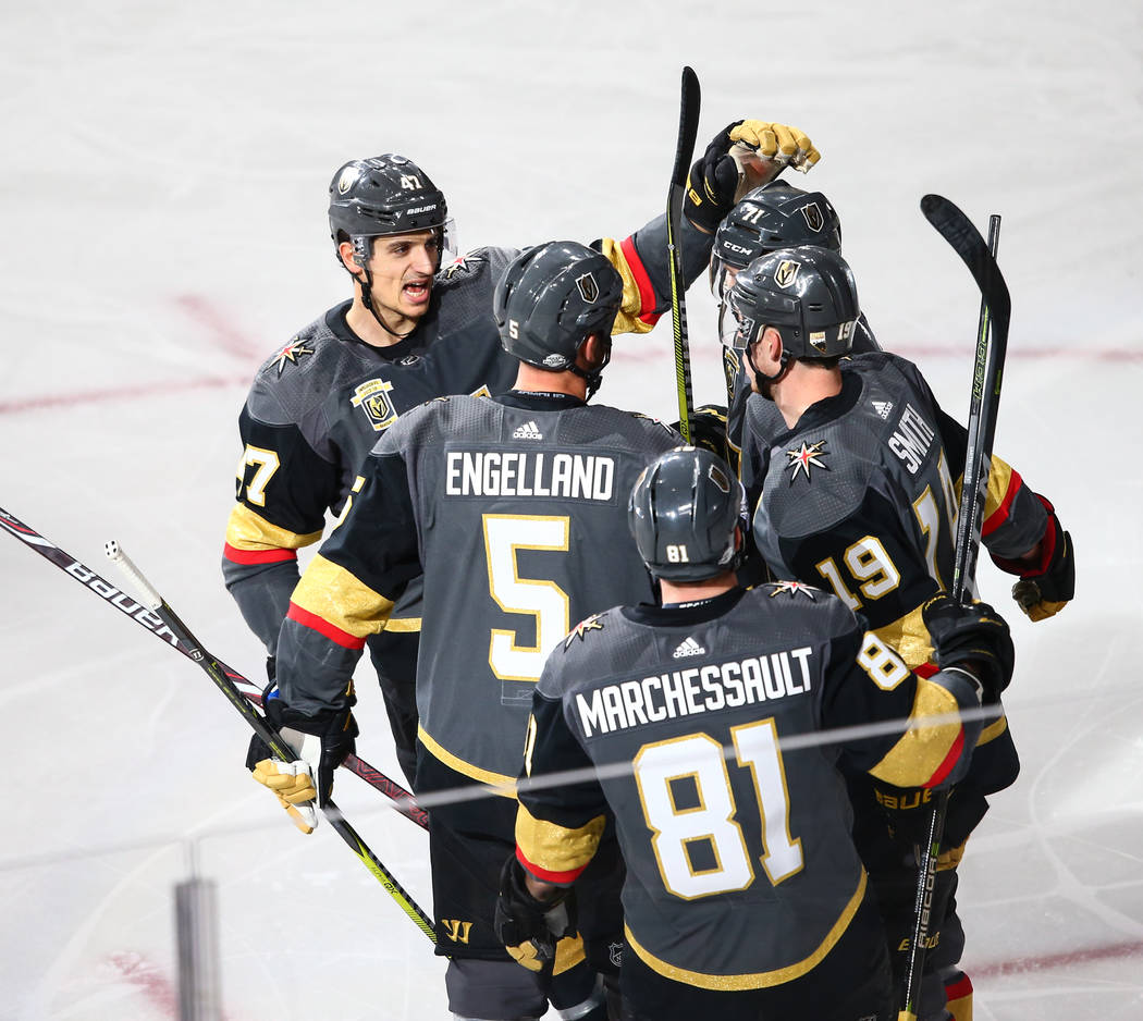 Golden Knights players celebrate a goal by right wing Reilly Smith (19) against the Montreal Canadiens during an NHL hockey game at T-Mobile Arena in Las Vegas on Saturday, Feb. 17, 2018. Chase St ...