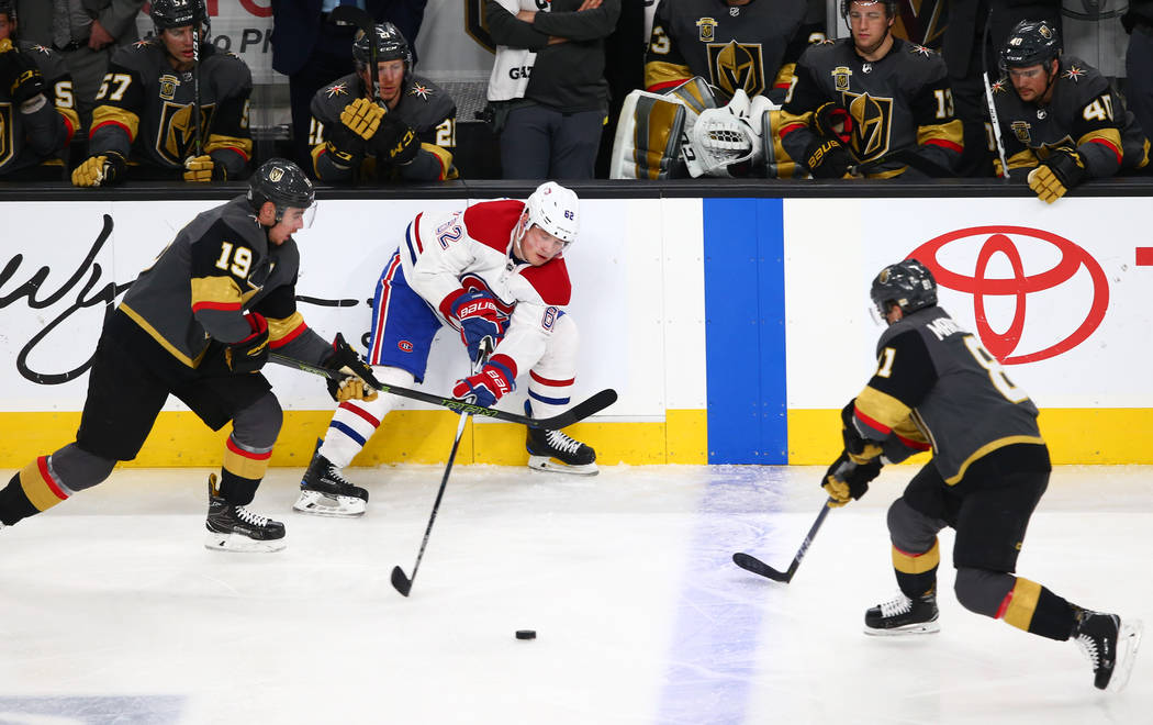 Golden Knights right wing Reilly Smith (19) and center Jonathan Marchessault (81) battle for the puck against Montreal Canadiens left wing Artturi Lehkonen (62) during the second period of an NHL  ...